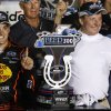 Photo -   Austin Dillon, left, celebrates with his grandfather Richard Childress in the winner's circle of the NASCAR Nationwide auto race at Kentucky Speedway in Sparta, Ky., Friday, June 29, 2012. (AP Photo/James Crisp)