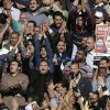 Supporters of Muslim Brotherhood and Egyptian President Mohammed Morsi, pictured at right, chant slogans during the funeral of three victims who were killed during Wednesday\'s clashes outside Al-Azhar mosque, the highest Islamic Sunni institution, Friday, Dec. 7, 2012. During the funeral, thousands Islamist mourners chanted,