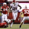 Oklahoma\'s Dejuan Miller (24) goes for extra yards against Nebraska\'s Dejon Gomes (7) and Matt O\'Hanlon (33) during the second half of the college football game between the University of Oklahoma Sooners (OU) and the University of Nebraska Cornhuskers (NU) on Saturday, Nov. 7, 2009, in Lincoln, Neb. Photo by Chris Landsberger, The Oklahoman