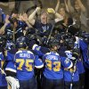 St. Louis Blues players celebrate their 2-1 overtime win over the Los Angeles Kings in Game 1 of their first-round NHL hockey Stanley Cup playoff series, Tuesday, April 30, 2013, in St. Louis. (AP Photo/Bill Boyce)