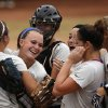 Ooloagah\'s Alex Edinger (11) celebrates with her teammates after winning a 4A state softball semifinals game between Oolagah-Talala and Tuttle at ASA Hall of Fame Stadium in Oklahoma City, Okla., Friday, Oct. 12, 2012. Photo by Garett Fisbeck, The Oklahoman