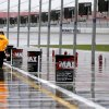 Photo - A track security guard walks along pit road during a rain delay before practice for the NASCAR Nationwide and Sprint Cup Series auto race, Friday, March 8, 2013 in Las Vegas. (AP Photo/Julie Jacobson)