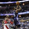 Photo - Charlotte Bobcats guard Kemba Walker (15) shoots past Washington Wizards guard John Wall (2) during the first half of an NBA basketball game on Wednesday, April 9, 2014, in Washington. (AP Photo/Nick Wass)