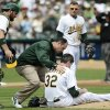 Photo -   Oakland Athletics pitcher Brandon McCarthy (32) is tended to by a trainer after being struck in the head by a ball hit by Los Angeles Angels' Erick Aybar in the fourth inning of a baseball game, Wednesday, Sept. 5, 2012, in Oakland, Calif. McCarthy was sent to the hospital, and according to the team he never lost consciousness. The Angels won 7-1. (AP Photo/The Contra Costa Times, Doug Duran)