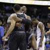 Photo - After making the game-winning shot, Orlando Magic's Tobias Harris, left, gets a hug from teammate Glen Davis as Oklahoma City Thunder's Kevin Durant, right, walks off the court after an NBA basketball game in Orlando, Fla., Friday, Feb. 7, 2014. Orlando won 103-102. (AP Photo/John Raoux)