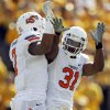 Oklahoma State wide receiver Michael Harrison, left, is congratulated by teammate Jeremy Smith after Harrison caught a 27-yard touchdown pass during the first half of an NCAA college football game against Missouri Saturday, Oct. 22, 2011, in Columbia, Mo. (AP Photo/Jeff Roberson)