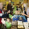"""Jon Dailey, with """"Jon\'s Turquoise"""" shows some jewelry to Sheila Guffey during the Made in Oklahoma Festival at the Reed Conference Center in Midwest City, OK, Saturday, May 31, 2014, Photo by Paul Hellstern, The Oklahoman"""