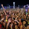 Photo - Carnival goers dance to music by Krewella at the Electric Daisy Carnival, Saturday, June 21, 2014, in Las Vegas. The festival sold over 130,000 tickets per night to the three-day ode to electronic dance music held at the Las Vegas Motor Speedway. (AP Photo/John Locher)