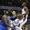 Charlotte Bobcats\' Kemba Walker, right, is fouled as he drives on Dallas Mavericks\' Vince Carter, left, and Chris Kaman, back, during the first half of an NBA basketball game in Charlotte, N.C., Saturday, Nov. 10, 2012. (AP Photo/Chuck Burton)