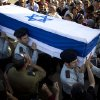 Israeli Captains of the Armored Corps carry the coffin of Captain Natan Cohen, platoon commander, during his funeral at the military cemetery in Modiin, near Jerusalem Israel, Wednesday, July 23, 2014. Cohen, 23, was killed while fighting in the Gaza Strip on Tuesday. (AP Photo/Ariel Schalit)