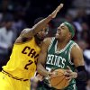 Boston Celtics\' Paul Pierce, right, is stopped by Cleveland Cavaliers\' Kyrie Irving during the second quarter of an NBA basketball game, Tuesday, Jan. 22, 2013, in Cleveland. (AP Photo/Tony Dejak)