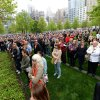 Members of the general public watch a screen projection on the World Trade Center Plaza during the dedication ceremony at the National September 11 Memorial Museum in New York on Thursday, May 15, 2014. (AP Photo/ Anthony Behar, Pool)