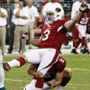 Arizona Cardinals\' Jay Feely (3) watches his winning kick against the Miami Dolphins as holder Dave Zastudil (9) kneels during overtime of an NFL football game, Sunday, Sept. 30, 2012, in Glendale, Ariz. The Cardinals won 24-21. (AP Photo/Ross D. Franklin)