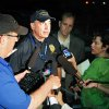 Photo - Aurora Police Chief Daniel Oates talks to media at the Aurora Mall where as many as 14 people were killed and many injured at a shooting at the Century 16 movie theatre in Aurora, Colo., Friday, July 20, 2012. (AP Photo/Ed Andrieski) ORG XMIT: COEA102