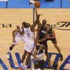 Oklahoma City\'s Serge Ibaka (9) and Miami\'s Chris Bosh (1) leap for the ball during the tipoff for Game 2 of the NBA Finals between the Oklahoma City Thunder and the Miami Heat at Chesapeake Energy Arena in Oklahoma City, Thursday, June 14, 2012. Photo by Bryan Terry, The Oklahoman