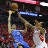 Oklahoma City\'s Kevin Martin (23) shoots the ball beside Houston\'s Greg Smith (4) during Game 6 in the first round of the NBA playoffs between the Oklahoma City Thunder and the Houston Rockets at the Toyota Center in Houston, Texas, Friday, May 3, 2013. Oklahoma City won 103-94. Photo by Bryan Terry, The Oklahoman