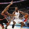 Chicago\'s Ben Gordon (7) guards Oklahoma City\'s Kyle Weaver (5) in the first half of the NBA basketball game between the Chicago Bulls and the Oklahoma City Thunder at the Ford Center in Oklahoma City, Wednesday, March 18, 2009. PHOTO BY NATE BILLINGS, THE OKLAHOMAN ORG XMIT: KOD
