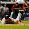 Photo - Washington Nationals' Ryan Zimmerman  scores during the seventh inning of a baseball game against the Colorado Rockies on Monday, July 21, 2014, in Denver. (AP Photo/Jack Dempsey)