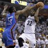 Memphis Grizzlies guard O.J. Mayo (32) drives against Oklahoma City Thunder guard James Harden (13) during the first half of Game 4 of a second-round NBA basketball playoff series on Monday, May 9, 2011, in Memphis, Tenn. (AP Photo/Wade Payne)