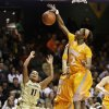 Photo - Tennessee forward Jasmine Jones (2) blocks a shot by Vanderbilt guard Jasmine Lister (11) in the first half of an NCAA basketball game on Thursday, Jan. 24, 2013, in Nashville, Tenn. (AP Photo/Mark Humphrey)