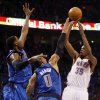 Oklahoma City\'s Kevin Durant (35) takes the game-winning shot over Dallas\' Shawn Marion (0) and Ian Mahinmi (28) during game one of the first round in the NBA playoffs between the Oklahoma City Thunder and the Dallas Mavericks at Chesapeake Energy Arena in Oklahoma City, Saturday, April 28, 2012. Oklahoma City won, 99-98. Photo by Nate Billings, The Oklahoman