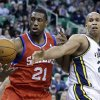 Photo - Philadelphia 76ers' Thaddeus Young (21) and Utah Jazz's Richard Jefferson, right, battle for a rebound in the first quarter of an NBA basketball game on Wednesday, Feb. 12, 2014, in Salt Lake City. (AP Photo/Rick Bowmer)