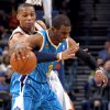 Oklahoma City\'s Russell Westbrook (0) tries to steal the ball from New Orleans\' Chris Paul (3) during the NBA basketball game between Oklahoma City Thunder and New Orleans Hornet, Wednesday, Feb. 2, 2011 at the Oklahoma City Arena. Photo by Sarah Phipps, The Oklahoman