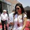 Photo - Fabiana Flosi partner of Bernie Ecclestone, left, president and CEO of Formula One Managmen walks at the paddock ahead of the Bahrain Formula One Grand Prix at the Formula One Bahrain International Circuit in Sakhir, Bahrain, Sunday, April 6, 2014. (AP Photo/Hassan Ammar)