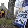 A sign for a Healing Prayer stands outside St. John\'s Episcopal Church near the scene of a school shooting in Newtown, Conn., Friday, Dec. 14, 2012. A man opened fire Friday inside two classrooms at the school where his mother worked as a teacher, killing 26 people, including 20 children. The killer, armed with two handguns, committed suicide at the school and another person was found dead at a second scene, bringing the toll to 28, authorities said. A law enforcement official identified the gunman as 20-year-old Adam Lanza. (AP Photo/Jessica Hill)