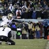 New Orleans Saints\' Shayne Graham kicks the game-winning field goal in front of teammate Luke McCown during the second half of an NFL wild-card playoff football game against the Philadelphia Eagles, Saturday, Jan. 4, 2014, in Philadelphia. (AP Photo/Matt Rourke)