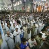 Shiite Muslim worshippers pray at the holy shrine of Imam Hussein during Friday prayers in the Shiite holy city of Karbala, 50 miles (80 kilometers) south of Baghdad, Iraq, Friday, July 11, 2014. The Sunni militant blitz led by the Islamic State extremist group has effectively cleaved the country along ethnic and sectarian lines — the swath of militant-held Sunni areas, the Shiite-majority south and center ruled by the Shiite-led government in Baghdad and the Kurdish north. (AP Photo)