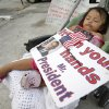 Photo - FILE - This April 30, 2014, file photo shows Diana Jimenez, 2, as she sleeps in a stroller during a rally sponsored by local immigrant rights organizations, in Homestead, Fla. Jimenez's father was deported to Guatemala two years ago leaving Jimenez and four siblings in the U.S. What can President Barack Obama actually do without Congress to change U.S. immigration policies? A lot, it turns out. (AP Photo, File)