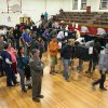 Photo -   As the polls get set to close, voters wait in line to cast their ballots in the Jefferson Middle School gym, Tuesday, Nov. 6, 2012, in Albuquerque, N.M. (AP Photo/Jake Schoellkopf)