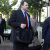 Photo -   Former Major League Baseball pitcher Roger Clemens, center, follows his attorney Rusty Hardin, right, as they arrive at federal court in Washington, Thursday, May 24, 2012. Attorney Michael Attanasio is at left. (AP Photo/Charles Dharapak)