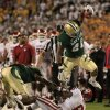 Baylor running back Jarred Salubi (21) leaps out of bounds over Oklahoma\' Demontre Hurst (6) following a long run in the first half of an NCAA college football game Saturday, Nov. 19, 2011, in Waco, Texas. (AP Photo/Tony Gutierrez)