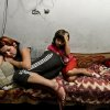 Photo - A mother and child lie on the bed in the bomb shelter in Petrovskiy district, in Donetsk, eastern Ukraine, Monday Sept. 1, 2014. The Petrovskiy district of Donetsk is currently a frontline and one of the districts which has suffered the most from the artillery fights between Ukrainian army and Pro-Pussian rebels. (AP Photo/Mstislav Chernov)