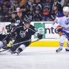 Edmonton Oilers center Teemu Hartikainen, right, controls the puck as Los Angeles Kings\' Dustin Penner, left, Trevor Lewis (22) and Matt Greene defend during the first period of an NHL hockey game, Monday, April 2, 2012, in Los Angeles. (AP Photo/Richard Hartog) ORG XMIT: CARH104
