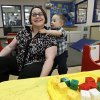 Photo -   In this April 4, 2012, photo, Kelly Andrus plays with her son Bradley, in his classroom at Children's Choice Learning Centers Inc., in Lewisville, Texas. Bradley, who turns three in a couple of weeks, was diagnosed a year ago with mild autism. For the first time in nearly two decades, experts want to rewrite the definition of autism. Some parents fear that if it's narrowed and their kids lose the label, they may also lose out on special therapist. (AP Photo/Tony Gutierrez)