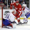 Detroit Red Wings\' Tomas Jurco (26), of Slovakia, has his shot stopped by Montreal Canadiens goalie Carey Price (31) as teammate Francis Bouillon (55) helps defend the goal during the first period of an NHL hockey game Thursday, March 27, 2014, in Detroit. (AP Photo/Duane Burleson)