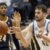 Photo - Minnesota Timberwolves forward Kevin Love (42) makes a pass with Indiana Pacers forward Paul George (24) watching during the first half of their NBA basketball game, Wednesday, Feb. 19, 2014 in Minneapolis. (AP Photo/Andy Clayton-King)