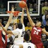 Photo -   Stanford forward Josh Huestis, right, reaches up to block a shot by Colorado forward Andre Roberson, center, as Stanford center Stefan Nastic covers in the first half of an NCAA college basketball game in Boulder, Colo., Thursday, Feb. 23, 2012. (AP Photo/David Zalubowski)