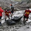Rescuers continue to retrieve bodies of flash flood victims three days after powerful typhoo Bopha remote New Bataan township, Compostela Valley in soutehrn Philippines leaving more than 200 people dead and 373 more missing Friday Dec. 7, 2012. Rescuers were digging through mud and debris Friday to retrieve more bodies strewn across a farming valley in the southern Philippines by a powerful typhoon. (AP Photo/Bullit Marquez)
