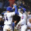 Chicago Cubs\' Alfonso Soriano right, celebrates with teammate Anthony Rizzo left, after hitting a two run home run against the Cincinnati Reds in the eighth inning during a MLB baseball game in Chicago, Thursday, Aug. 9, 2012. (AP Photo/Paul Beaty)