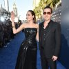Photo - Angelina Jolie, left, and Brad Pitt arrive at the world premiere of