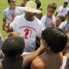 Former OU quarterback Jamelle Holieway gives a pep talk to a group of young football players during Holieway\'s Spirit of Oklahoma football camp in Weleetka, Okla., Friday, July 6, 2012. Photo by Nate Billings, The Oklahoman