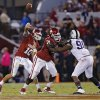 Oklahoma\'s Blake Bell (10) passes the ball over Tyrus Thompson (71) and TCU \'s Terrell Lathan (90) toduring the college football game between the University of Oklahoma Sooners (OU) and the Texas Christian University Horned Frogs (TCU) at the Gaylord Family-Oklahoma Memorial Stadium on Saturday, Oct. 5, 2013 in Norman, Okla. Photo by Chris Landsberger, The Oklahoman