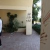 Bloodstains at the main gate believed to be from one of the American staff members of the U.S. Consulate, after an attack that killed four Americans, including Ambassador Chris Stevens on the night of Tuesday, Sept. 11, 2012, in Benghazi, Libya, Thursday, Sept. 13, 2012. The American ambassador to Libya and three other Americans were killed when a mob of protesters and gunmen overwhelmed the U.S. Consulate in Benghazi, setting fire to it in outrage over a film that ridicules Islam\'s Prophet Muhammad. Ambassador Chris Stevens, 52, died as he and a group of embassy employees went to the consulate to try to evacuate staff as a crowd of hundreds attacked the consulate Tuesday evening, many of them firing machine-guns and rocket-propelled grenades. Arabic writing reads,