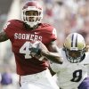 Oklahoma receiver Malcolm Kelly (4) runs after a catch for a third quarter 36-yard touchdown reception against Washington\'s Dashon Goldson (8) during the University of Oklahoma Sooners (OU) college football game against Washington at Gaylord Family - Oklahoma Memorial Stadium, Saturday, Sept. 9, 2006, in Norman, Okla. by Nate Billings, The Oklahoman