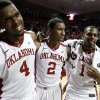 Photo - Oklahoma's Andrew Fitzgerald (4), Steven Pledger (2) and Sam Grooms (1) leave the court as the University of Oklahoma Sooners (OU) defeat the Kansas Jayhawks (KU) 72-66 in NCAA, men's college basketball at The Lloyd Noble Center on Saturday, Feb. 9, 2013 in Norman, Okla. Photo by Steve Sisney, The Oklahoman