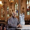 As young boy attending Catholic grade school, Joe Ross was an altar boy at the team Mass for Notre Dame players at the local Catholic parish in Chickasha the day before the Irish ended OU\'s winning streak in 1957. Now, he\'s Father Ross, pastor of Blessed Sacrament Parish in Lawton. Having later attended Notre Dame, that day with the Irish in 1957 is one that lives on for this Oklahoma priest.. He met with a reporter and posed for photos in St. Joseph\'s Old Cathedral in downtown Oklahoma City on Monday, Oct. 22, 2012. Photo by Jim Beckel, The Oklahoman